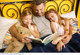 father-reading-to-girls